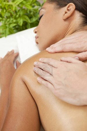 Woman Relaxing At Health Spa Having Massage Treatment