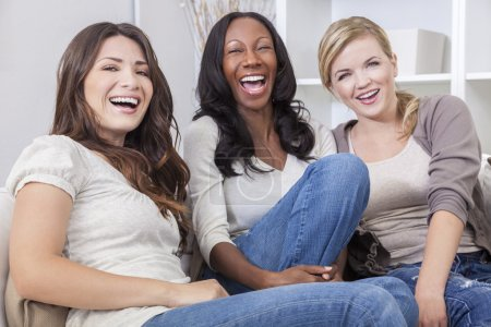 Interracial group of three beautiful young women f...
