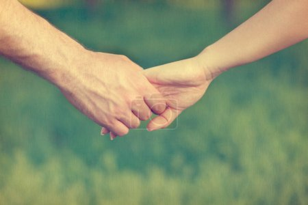 Photo for Vintage background with a couple holding hands - Royalty Free Image