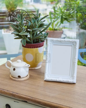 Photo for Empty picture frame on the table. - Royalty Free Image