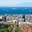 The cityscape of Thessaloniki, as it seen from Ano Poli, with its port and Mount Olympus in the light haze on the background, Greece.