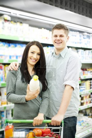 Photo for Young couple shopping at supermarket - Royalty Free Image