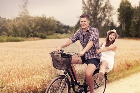 Photo for Couple have fun riding on bike - Royalty Free Image