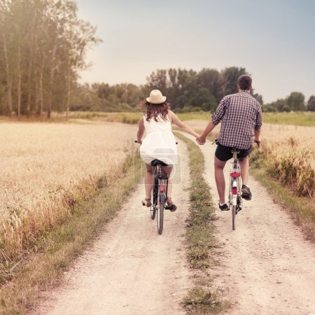 Romantic couple cycling together