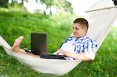 Working on hammock with laptop