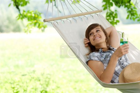 Photo for Young woman resting on hammock - Royalty Free Image