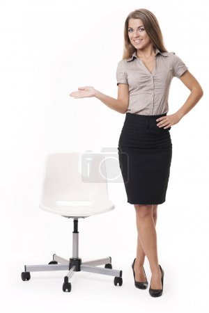 Photo for Woman standing near office chair - Royalty Free Image