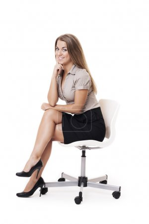 Photo for Smiling woman sitting on office chair - Royalty Free Image