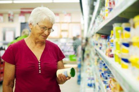 Senior woman at supermarket