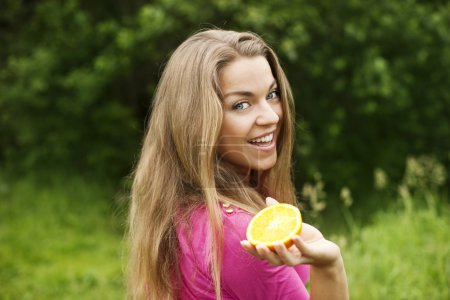 Photo for Young woman with slice of orange - Royalty Free Image