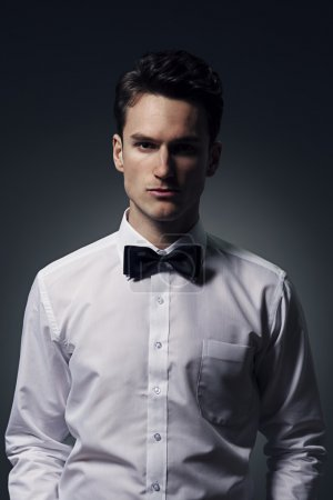 Man wearing in a shirt and bow tie
