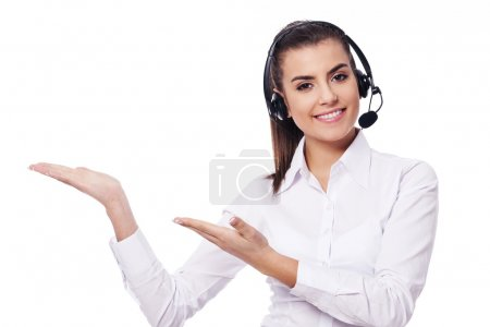 Smiling woman in headset presentation something