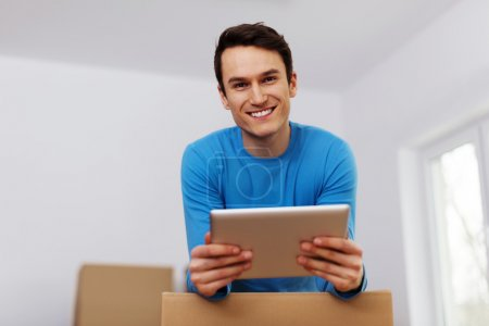 Photo for Happy man organize relocation in his new apartment - Royalty Free Image