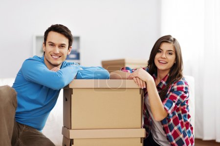 Photo for Portrait of young couple with moving boxes - Royalty Free Image