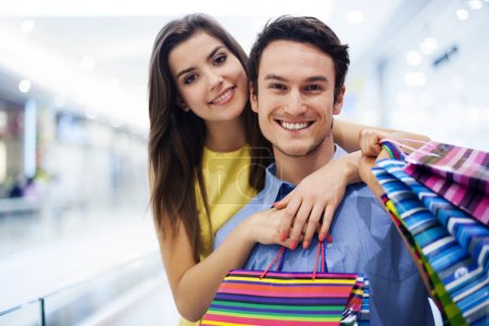 Photo for Loving couple in shopping mall - Royalty Free Image