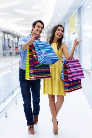Happy young couple shopping