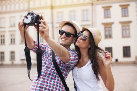 Photo for Happy tourists taking photo of themselves - Royalty Free Image