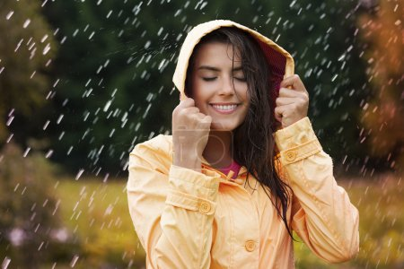 Natural female beauty in autumn rain