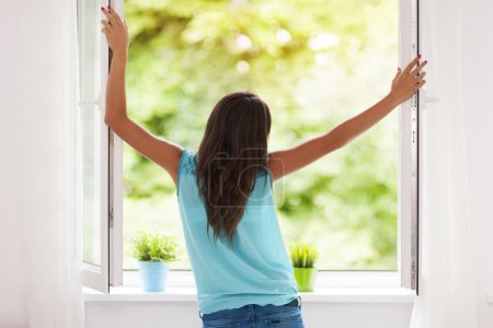 Photo for Young woman breathing fresh air during the summer - Royalty Free Image