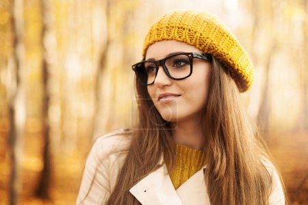Photo for Portrait of beautiful woman wearing fashion glasses during the autumn - Royalty Free Image