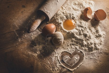 Photo for Rustic baking with symbol of heart in flour - Royalty Free Image