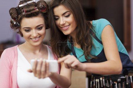 Makeup artist and female customer
