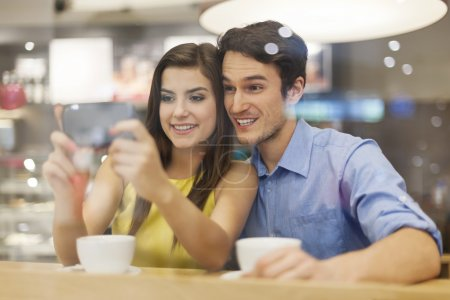 Couple checking something on mobile phone