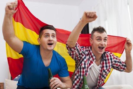 Men watching football match on TV