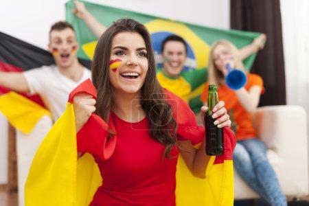 Spanish girl cheering football match