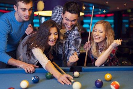 Friends on billiard