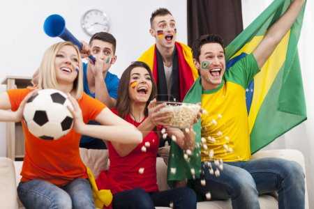 Friends supporting football team