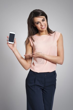 Woman showing screen of mobile phone
