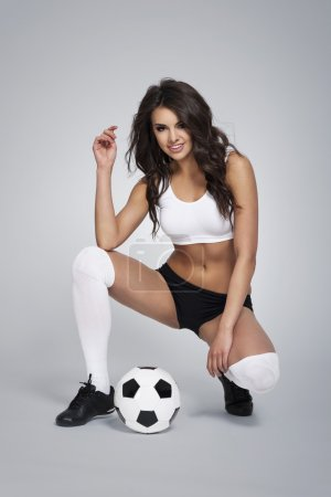 Sexy soccer player with ball