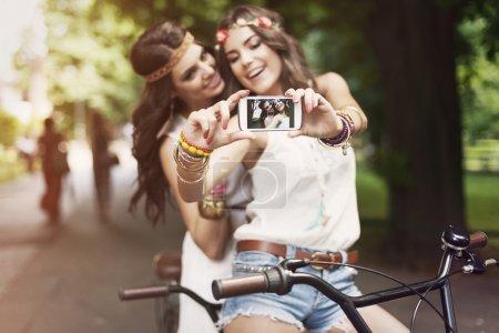 Hippie girls taking selfie