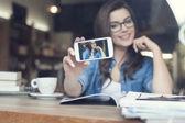 Attractive woman taking self portrait