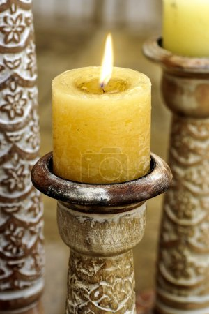 Golden candle on oriental candle holder