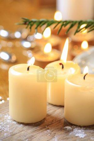 Beautiful golden candles. Christmas eve mood. Selective focus