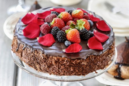 Chocolate cake with strawberries. Birthday party table