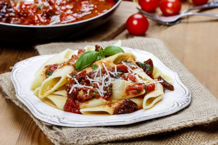 Penne with dried tomatoes. Italian cuisine, delicious