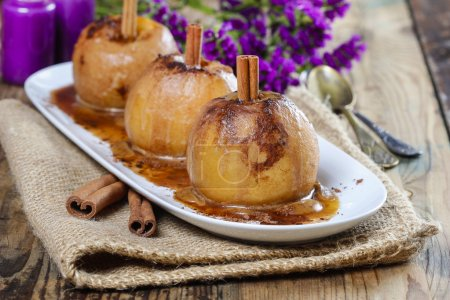 Apples with cinnamon on jute napkin. Sea lavender in the back
