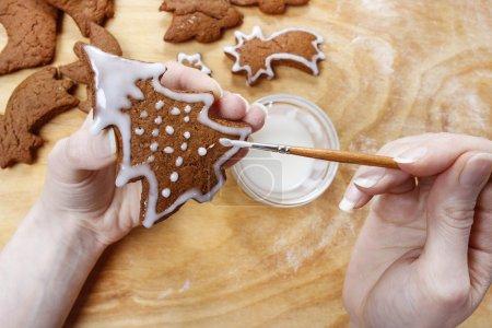 Preparing gingerbread cookies for christmas. Steps of making bis