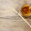 Bowl of honey on wooden table. Symbol of healthy l...