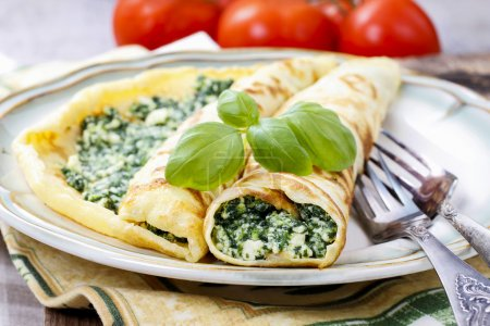 Photo for Mediterranean cuisine: crepes stuffed with cheese and spinach - Royalty Free Image