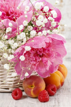 Photo for Basket of pretty pink peonies, white rustic background - Royalty Free Image