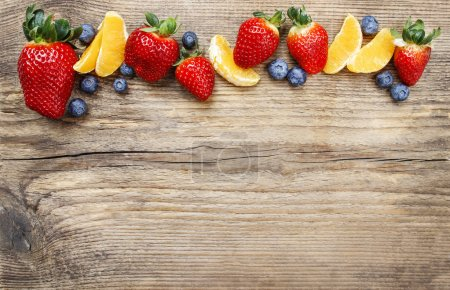 Delicious fruits on wooden background. Top view, copy space