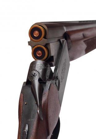 Opened double-barrelled hunting gun with two blue cartridges right rear closeup view isolated on white