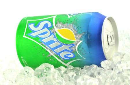 Sprite drink in a can on ice isolated on white background