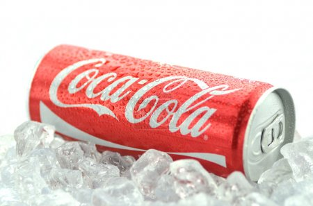 Photo for Bottle of Coca-Cola drink on ice cubes - Royalty Free Image
