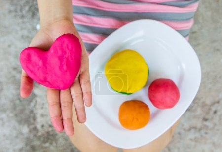 Creating Heart toys from play dough