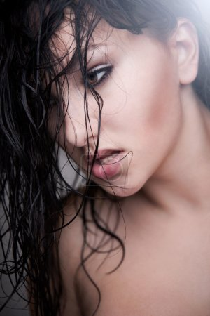 Pretty woman with wet hair